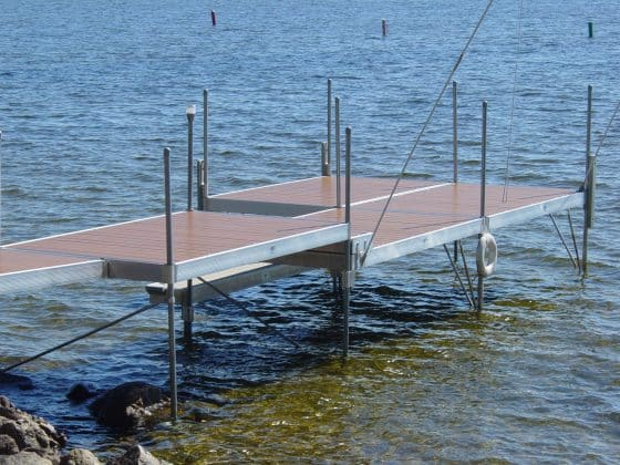 Step kit allows lowering part of a dock system, while maintaining shore elevation