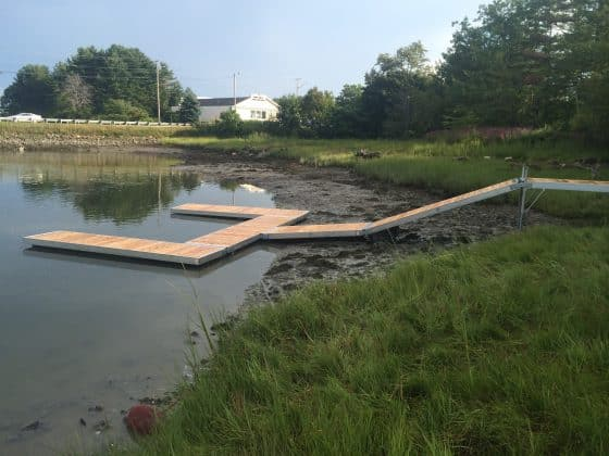 Tidal water dock ramp and floating boat dock.