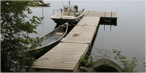 Wood docks blend in naturally with the lakeside environment.