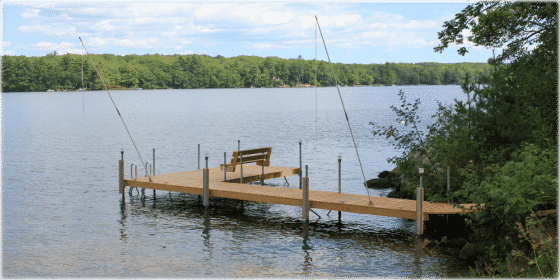 Accessorize your wood dock with bumpers, boat whips, and a bench.