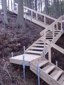 Steep hill stairs through woods